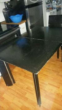 Solid table with 4 chairs need a bit of paint it ' Laval, H7R 4K3