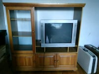 gray CRT television and brown wooden TV hutch Montréal, H1L 5P2