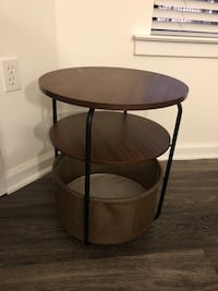 Side table with removable basket.
