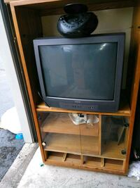 gray CRT television with brown wooden TV hutch Detroit, 48238