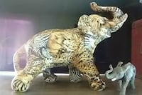 brown and white tiger figurine Akron