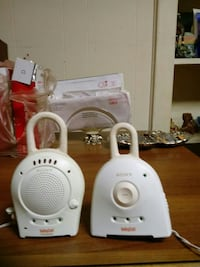 pair of white baby cell monitors