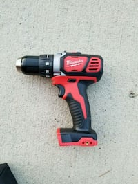 red and black Milwaukee cordless impact wrench Humble, 77338