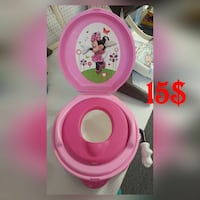 pink and white plastic Minnie Mouse potty trainer