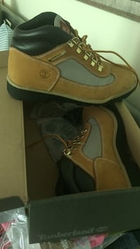 pair of brown Timberland work boots 30 km