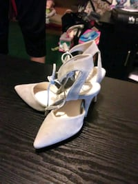 pair of white suede d'Orsay pointed ankle-strap st