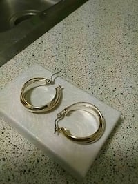 Silver/ gold earrings, not real gold. Made really