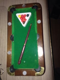 brown, green, and red portable billiard play set