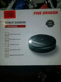 black and gray robot sweeper  Cypress, 90630