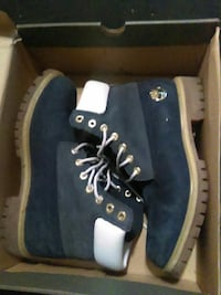 pair of black-and-white Timberland work boots