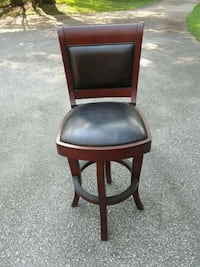 Two Mohonony and leather swivel barstools Malvern, 19355