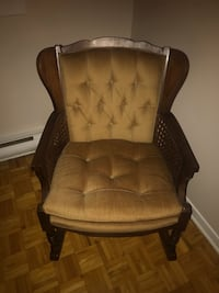 brown wooden frame brown padded armchair Montréal, H4N 2L7