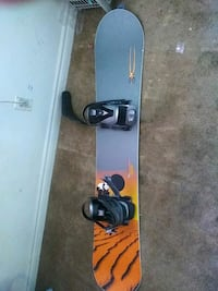 black and gray snowboard with bindings adult size