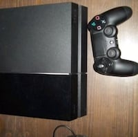 black Xbox One console with controller Winnipeg