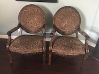 two brown wooden framed padded armchairs Elk Grove, 95758