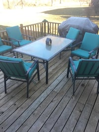 rectangular glass top table with four chairs