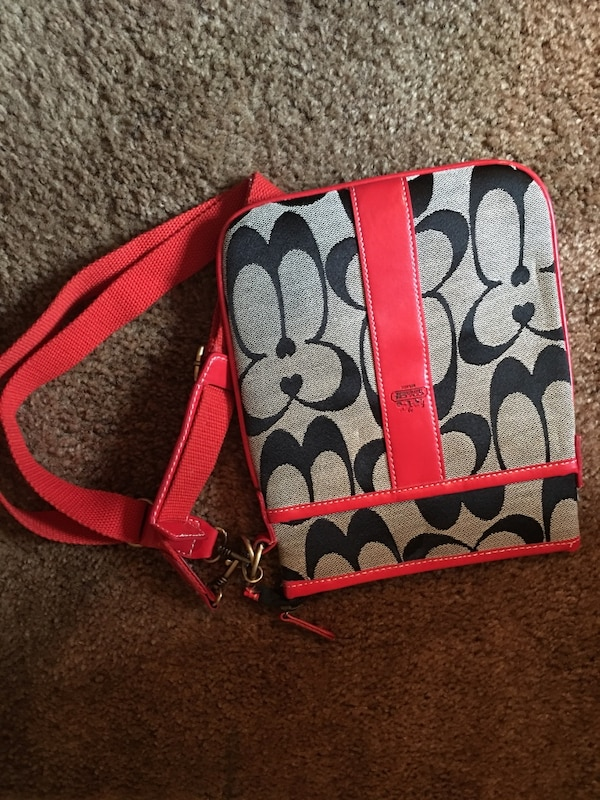 red and black Coach monogram leather handbag