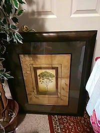 tree painting with square brown wood frame