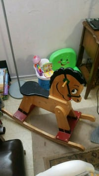 brown and black wooden ride-on rocking horse Kitchener, N2M 2G7