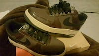 brown-and-white Nike Air Force 1 low-top shoes wit