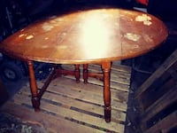 brown wooden round table with chairs Detroit, 48202