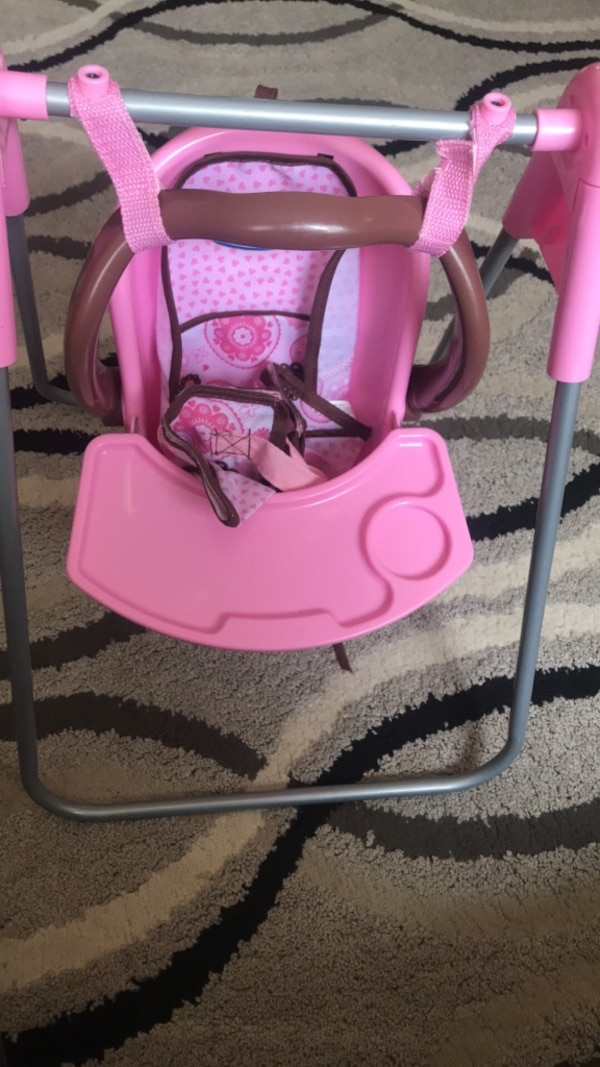 pink and white portable swing