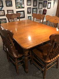 Rectangular brown wooden table with six chairs dining set null