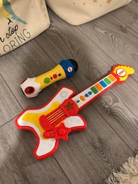 Fisher price guitar and recording microphone
