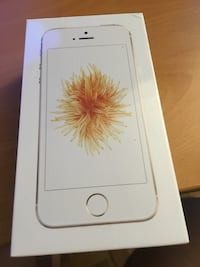 gold iPhone SE 32GB sealed with new case