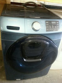 gray front-load clothes washer 784 km
