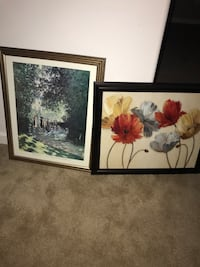 two black wooden framed painting of flowers Elon