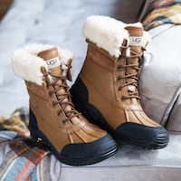 pair of brown UGG leather Adirondack boots