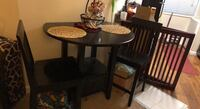 round black wooden table with two chairs Alexandria, 22305