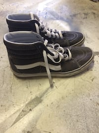 pair of black-and-white high top sneakers