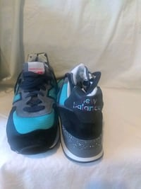 pair of black-and-blue Nike basketball shoes St. Louis, 63135