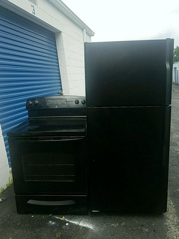 black top-mount refrigerator and electric stove