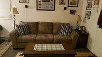 gray velvet 3-seat couch and brown wooden coffee t