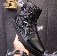 pair of black leather combat boots Nevada