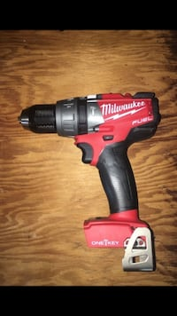 red and black Milwaukee power drill