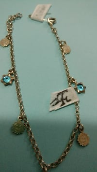 silver-colored charm necklace
