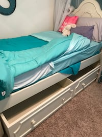 Girls twin/trundle bed w Chester drawers, book shelf and mattress.