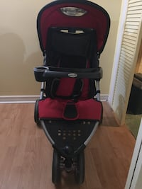 baby's black and red stroller Whitby, L1N 2K4