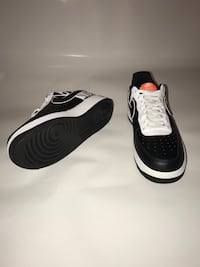 pair of black-and-white Nike running shoes Jacksonville, 32258
