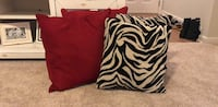 4 gently used Throw Pillows (2 red/2 zebra). Originally bought to display on my bed. However, didn't match decor. Willing to negotiate on the price! Pensacola, 32534