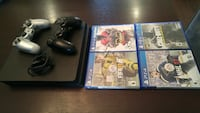 Sony PS4 console with controller and game cases Mission, V2V 7P9