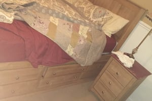 Bed with drawers to chest of drawers headboard