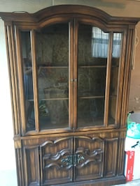 solid wooden china cabinet with glass doors and metal accents Burlington, L7N 3C2