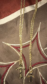 Two 10k Gold rope chains with Two T Charms, one small one large .  Fayetteville, 28311