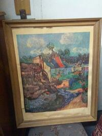 painting of body of water in brown wooden frame