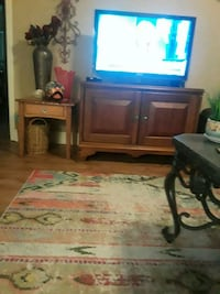brown wooden TV standcreen television 572 mi